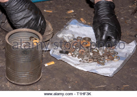 Car mechanic searching in pile of screwdrivers. Car mechanic concept with hands - Stock Photo