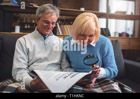 Interesting picture of white-haired man and woman sitting on the - Stock Photo