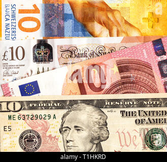 Money background from different paper currency close up - Stock Photo