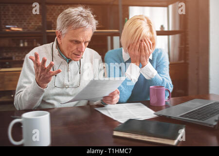 Hard and full of desperate picture of old couple suffering. Ther - Stock Photo