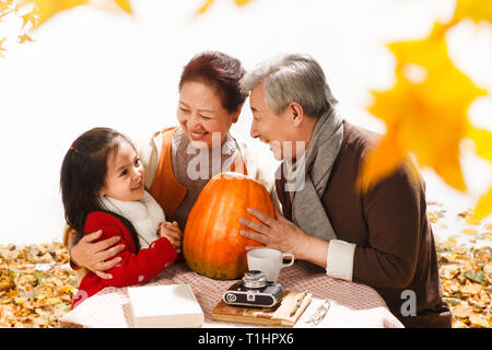 Grandchildren and pumpkin - Stock Photo