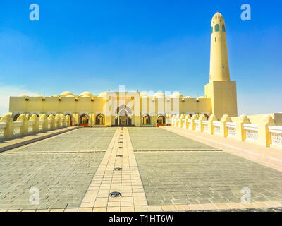 Walkway towards State Grand Mosque and minaret in a sunny day with blue sky in Doha Downtown, Middle East, Arabian Peninsula, Persian Gulf. Famous - Stock Photo