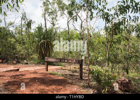 Trail sign for the rock holes at Litchfield National Park with lush bushland in the NT of Australia - Stock Photo