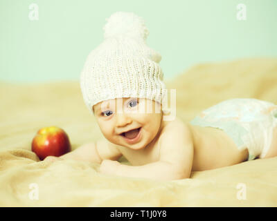 Little boy in white hat with apple - Stock Photo