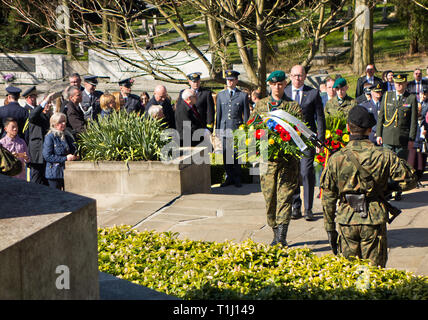 Laying  wreath at the British war cemetery in Poznan Poland to mark the 75th anniversary of 50 airmen being killed  for their part in the great escape - Stock Photo