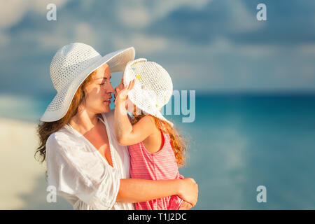 Happy mother and daughter on the beach on Maldives at summer vacation - Stock Photo