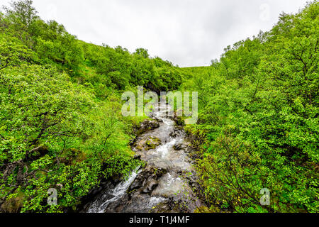River near Hundafoss waterfall high angle aerial view in Skaftafell, Iceland with water cliff in green summer rocky landscape wide angle - Stock Photo