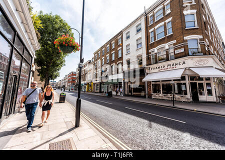 London, UK - June 24, 2018: Center of downtown during sunny summer day in Westbourne Grove near Leicester square wide angle view with stores shops - Stock Photo