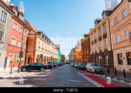 Warsaw, Poland - August 22, 2018: Famous old town in capital city during sunny summer day with nobody on cobblestone street alley and Le Regina hotel  - Stock Photo
