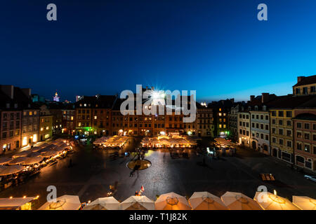 Warsaw, Poland - August 22, 2018: Historic cityscape panorama with high angle view of dark architecture rooftop buildings in old town market square at - Stock Photo