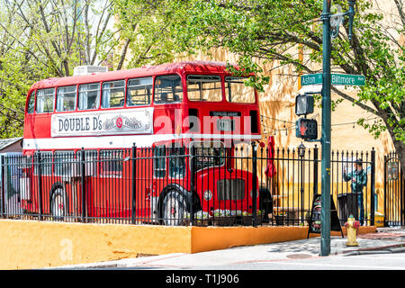 Asheville, USA - April 19, 2018: People double decker d's bus cafe restaurant outside on a street serving coffee drinks and desserts in North Carolina - Stock Photo