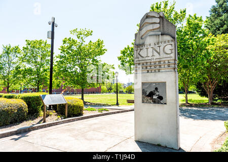 Atlanta, USA - April 20, 2018: Sign to Martin Luther King Jr National historic site in Georgia city in summer with park view - Stock Photo