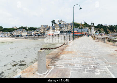 Cancale, France - July 27, 2018: Scenic view of the waterfront of the town of Cancale from the harbour - Stock Photo