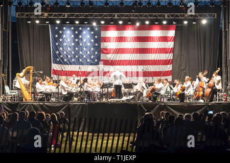 East Islip, NY, USA - 15 July 2017: The new Long Island Concert Orchestra performs for free at night, under the stars, at Heckshire State Park. - Stock Photo
