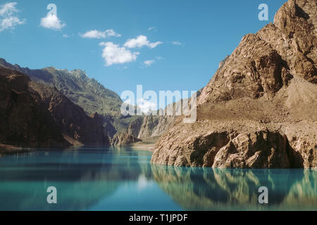 reflection in the water of Attabad Lake, surrounded by mountains in Karakoram range. Gojal Hunza, Gilgit Baltistan, Pakistan. - Stock Photo
