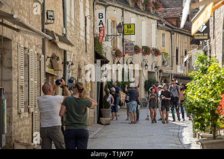 Rocamadour, France - September 3, 2018: Tourists walking in the medieval centre of Rocamadour. France - Stock Photo