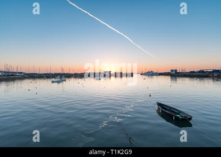 Penzance, Cornwall, UK. 27th Mar, 2019. UK Weather. Feeling cooler than yesterday, but still a glorious sunrise at Penzance harbour, and soon warming up once the sun came out. Credit: Simon Maycock/Alamy Live News - Stock Photo
