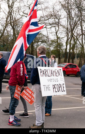 Towcester, Northamptonshire, UK. 27th Mar 2019. 'March to Leave' campaigners gather in Towcester, Northamptonshire, UK,  on Day 12 of their march from Sunderland to Parliament Square, London UK where they plan to arrive on March 29th. Brexiteers are challenging the way forward for Brexit, whilst discussions continue between the PM Theresa May, her government and parliament seeking a way forward for MV3.  Bridget Catterall Alamy Live News - Stock Photo