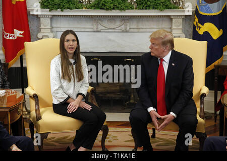 Washington, District of Columbia, USA. 27th Mar, 2019. United States President Donald J. Trump meets with Fabiana Rosales, wife of Venezuela's self-proclaimed interim president, Juan Guaido, in the Oval Office of the White House, in Washington, DC, on Wednesday, March 27, 2019 Credit: Martin H. Simon/CNP/ZUMA Wire/Alamy Live News - Stock Photo