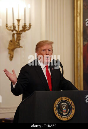 Washington, District of Columbia, USA. 27th Mar, 2019. United States President Donald J. Trump speaks during a Medal of Honor ceremony for Staff Sergeant Travis Atkins in the East Room of the White House, in Washington, DC, Wednesday, March 27, 2019. Staff Sergeant Atkins earned the award for his selfless act in Iraq, 2007, where he shielded fellow soldiers from a suicide bomber, saving the lives of three Credit: Martin H. Simon/CNP/ZUMA Wire/Alamy Live News - Stock Photo