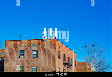 A Cellular antennas on the roof of a building in Brooklyn. - Stock Photo