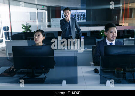 Business people in the control room - Stock Photo