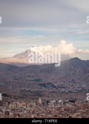 Cityscape of La Paz, Bolivia with Illimani Mountain rising in the background. The Andes - Stock Photo