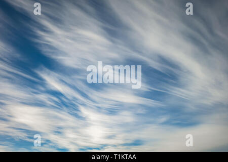 Blue sky background with tiny stratus cirrus striped clouds. Clearing day and Good windy weather - Stock Photo