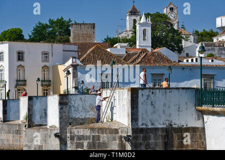 View on historic town of Tavira from Roman bridge over River Gilao. Algarve, Portugal - Stock Photo