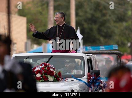 James Anthony Tamayo, bishop of the Catholic diocese of Laredo,  waves to the crowd during the Washington's Birthday Celebration parade in Laredo, TX. - Stock Photo