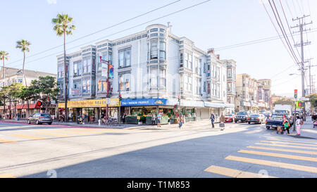 SAN FRANCISCO, USA - 10 Jul 2018: A heritage old cottage dominates a crossroads in Mission Street, in Liberty Street Historic District, a heritage nei - Stock Photo