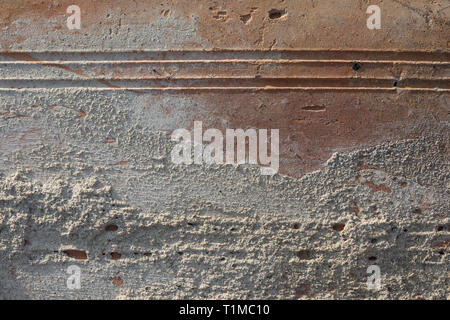 Texture in Close-up Of Old Dirty, Crumbly, Weathered Brick in Harsh Direct Sunlight - Stock Photo