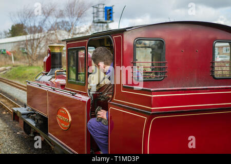 Engineer working on the interior of the Mark Timothy steam train on the Bure Valley railway at Wroxham and Hoveton train station - Stock Photo