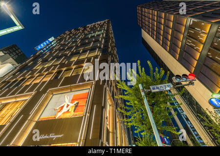 Ginza, Tokyo - December 2017 : Billboards and neon signs at Chuo dori street at Ginza luxurious shopping District by night. - Stock Photo
