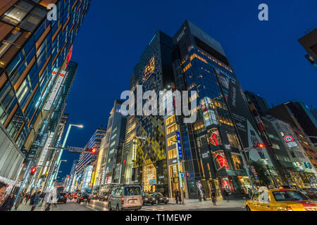 Ginza, Tokyo - December 2017 : Start of Christmas season in crowded Chuo dori street at Ginza luxurious shopping District by night. - Stock Photo