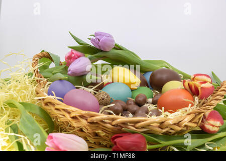 Easter party and arrival of spring with its symbols, eggs and tulips - Stock Photo