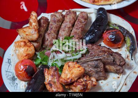 Lullaby in Sheet, Strawberry, Chicken Kebab, Eggplant, Tomato Kebab, Pepper Kebab. Chopped onion. Sumax - Stock Photo