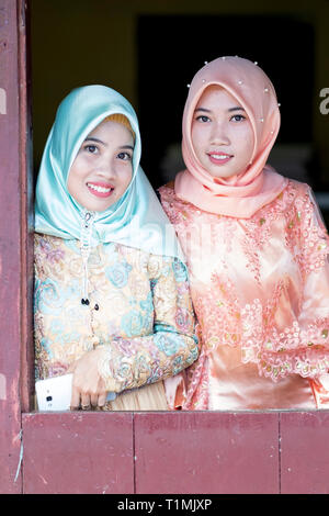 Two Muslim friends in traditional dress, Sulawesi, Indonesia - Stock Photo