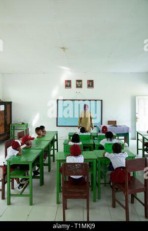 Muslim schoolchildren in class in Seram, Indonesia - Stock Photo