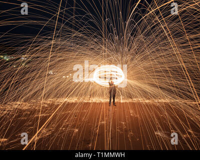 A steel wool shot on South Sands beach in Devon. Steel wool photography involves using a whisk,steel wool and a dog lead. - Stock Photo