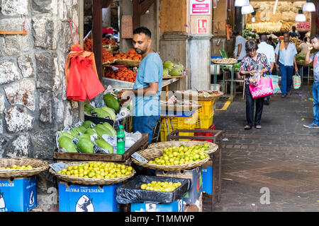 Port Louis, Mauritius - January 29, 2019: People and vendors at the Central Market in Port Louis, Mauritius. - Stock Photo