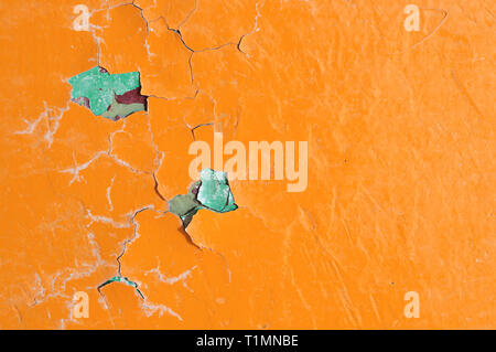 Texture background of bright orange peeling paint on the old rough surface - Stock Photo