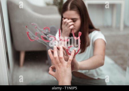 Beautiful young woman is stressed because of feeling ugly - Stock Photo