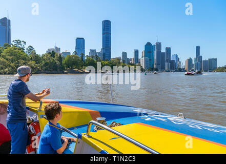 The downtown skyline from a CityCat ferry on the Brisbane River, Brisbane, Queensland, Australia - Stock Photo