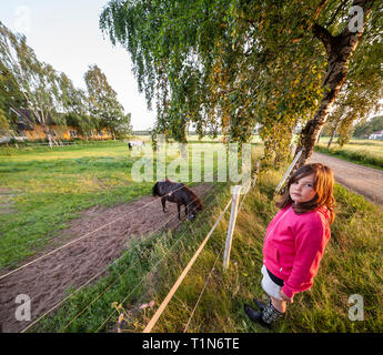Girl and a horse. Dalarna / Dalecarlia, Sweden, Scandinavia. - Stock Photo