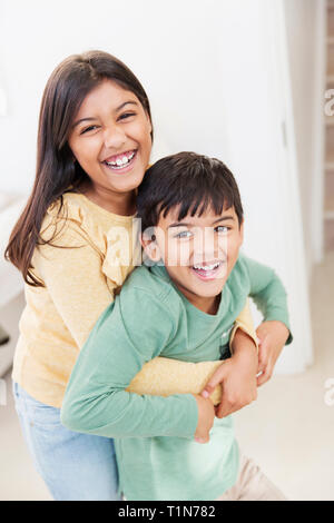 Portrait happy brother and sister - Stock Photo