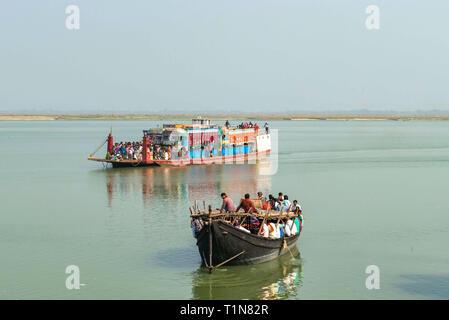 RAJMAHAL, BIHAR, INDIA. December 03-2015. Small and big ferries meeting on river Ganges while crossing between Rajmahal Bihar and Manikchak West Benga - Stock Photo