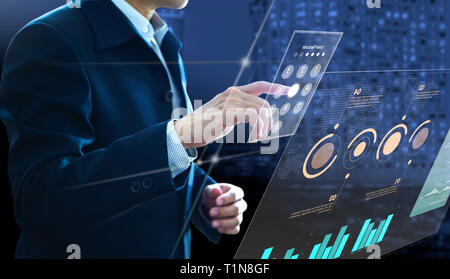 Businessman entering passcode on modern virtual touch screen as an access to investment risk management information and return on investment analysis  - Stock Photo