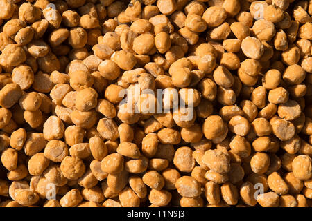 Pure cane sugar pebbles, produced by traditional methods in rural India - Stock Photo