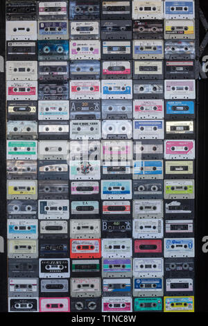 funny capture walking by the street in Phnom Penh, some old school music cassette stick together on a wall - Stock Photo